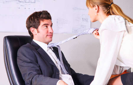 businesswoman is seducing her boss at office Stock Photo - 18687238