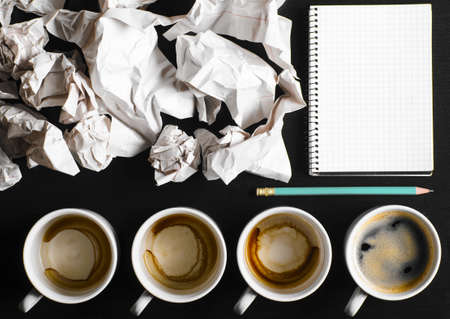 business creativity concept  empty and full cups of fresh espresso with crumple wads on desk Stock Photo - 19080779