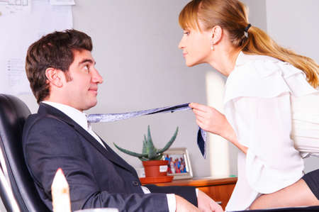businesswoman is seducing her boss at office Stock Photo - 19061132