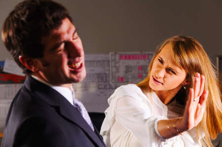 angry businesswoman is slapping across the businessman s face photo
