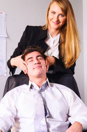 teammate: young businesswoman is making head massage to her teammate