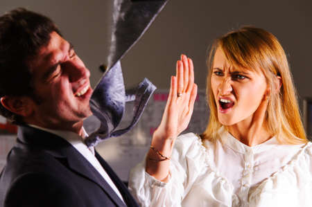 angry businesswoman is slapping across the businessman s face Stock Photo - 19288418