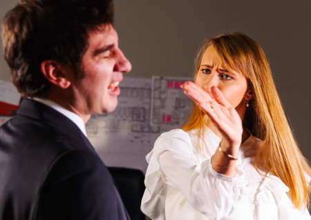 slap: angry businesswoman is slapping across the businessman s face