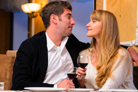 laughing embracing couple is sitting at restaurant and drinking wine Stock Photo - 19671871