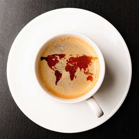 top of the world: cup of fresh espresso on table, view from above  Stock Photo