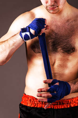 mma fighter is getting ready on gray background photo