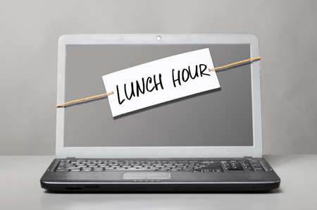 work break: laptop with note about lunch hour