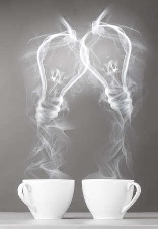 mug shot: creating idea  bulbs silhouette from steaming hot coffee cup