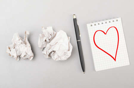 love letter  crumpled wads and notebook with heart picture photo