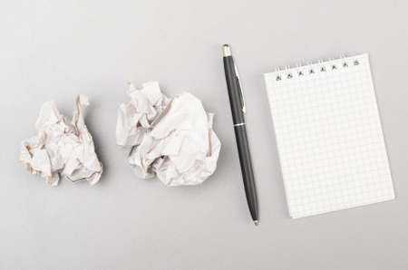 creative process  crumpled wads and blank notebook photo