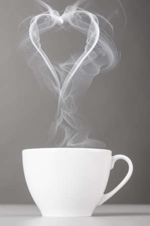 steaming coffee: love and coffee  heart silhouette from steaming hot coffee cup Stock Photo
