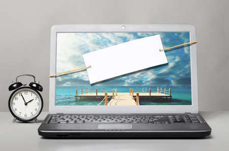 laptop with blank note on gray background Stock Photo - 19793506