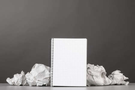 wads: creative process  crumpled wads and notebook on gray