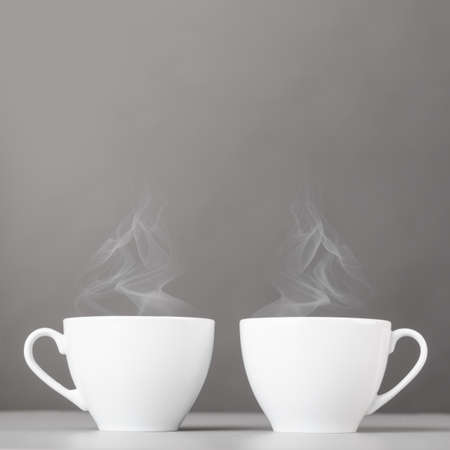 cups of hot coffee on gray background Stock Photo