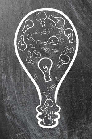 synergy: synergy  huge bulb made of small ones on chalk board Stock Photo