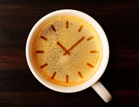 time table: coffee time  cup of fresh espresso with clock sign, view from above