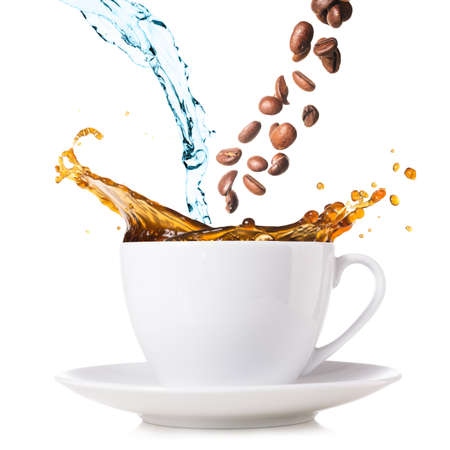 hot coffee is splashing in cup  water and beans are blending Stock Photo