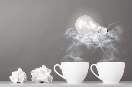 wads: creative process  crumpled wads and cup on gray Stock Photo