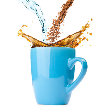 water and instant coffee are blending and splashing in cup  photo