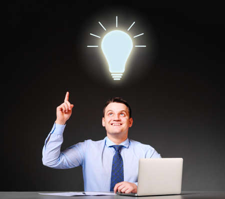 idea concept  businessman is sitting at his table with laptop photo