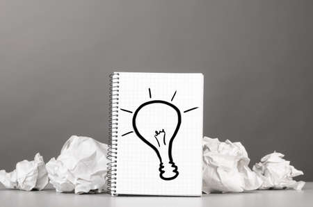 wads: creative process  crumpled wads and notebook with bulb picture