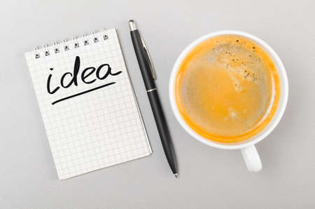 creative process  notebook with idea word and cup on gray Stock Photo - 20341552