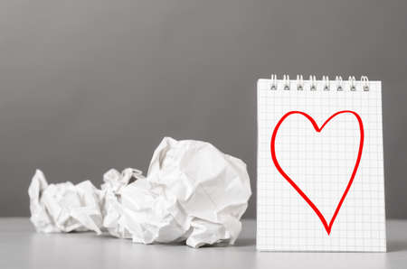 wads: creative process  crumpled wads and notebook with heart picture