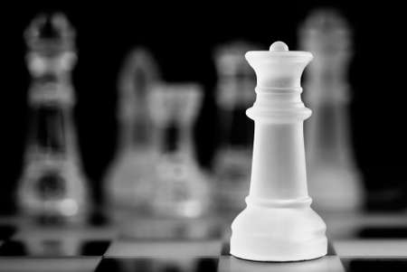 entertainment risk: Chess game concept, queen in dark