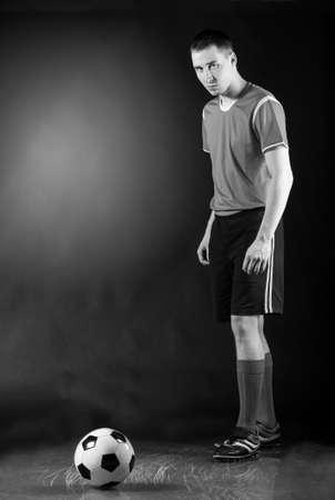 football socks: soccer player is preparing for free kick on dark background