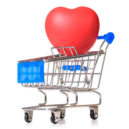 shopping cart with heart isolated on white photo