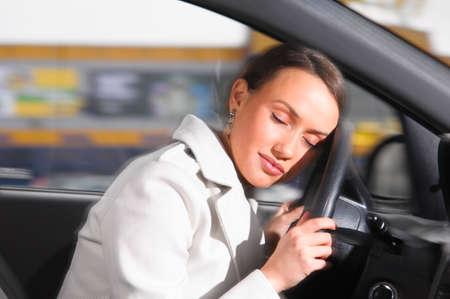 beautiful woman is sleeping in a car