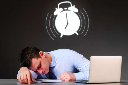 sleep well: tired businessman is sleeping at his table with laptop