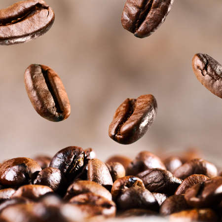 roasted coffee beans is falling down