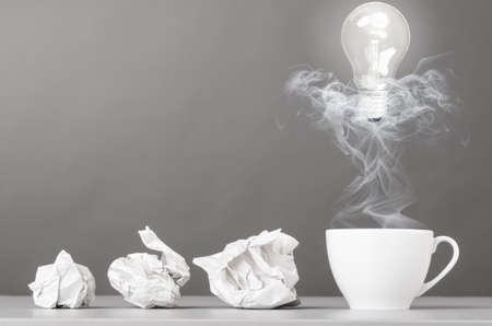 creative process  crumpled wads and cup on gray Stock Photo