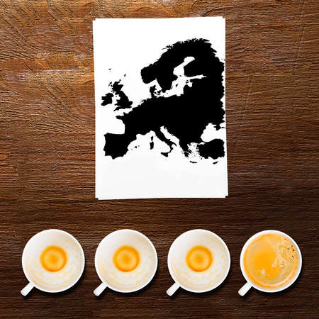 Europe  full and empty cups of fresh espresso, view from above photo