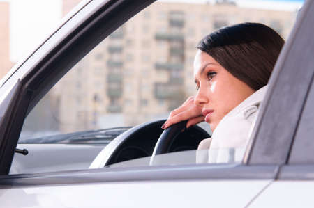 beautiful woman is resting in a car photo