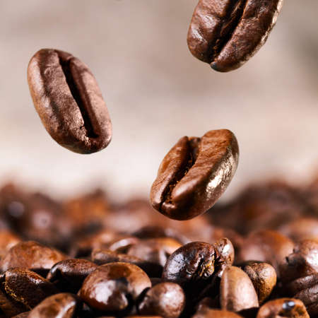 roasted coffee beans is falling down photo