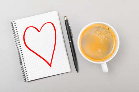 love  notebook with heart picture and cup on gray Stock Photo - 20731105