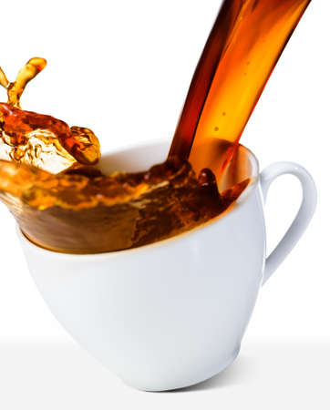hot coffee is splashing in cup photo