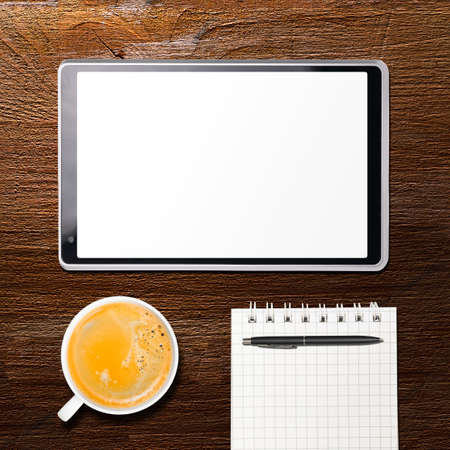 tablet computer and cup of coffee on table, view from above Stock Photo - 20731141