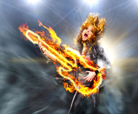 woman is playing rock music on fiery guitar and singing photo