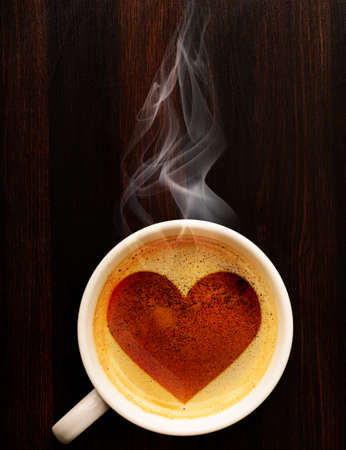 loving coffee  cup of fresh espresso with heart sign, view from above photo