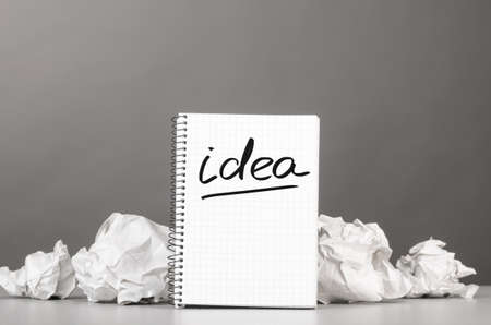 wads: creative process  crumpled wads and notebook with word idea Stock Photo