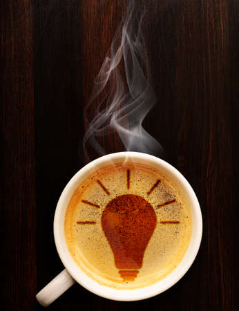 idea  cup of fresh espresso with bulb sign, view from above
