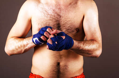 boxing tape: mma fighter is getting ready on gray background