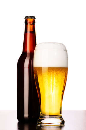 single beer bottle: glass of fresh lager beer with bottle cut out from white Stock Photo