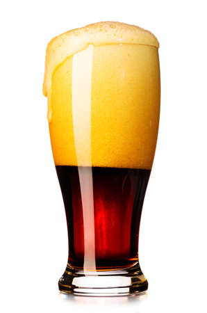 amber light: glass of fresh dark beer cut out from white Stock Photo
