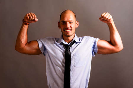 strong business man is showing his biceps Stock Photo