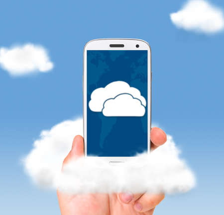 cloud technologies, male hand is holding modern smartphone in skies photo