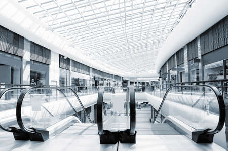view of a staircase in a shop: panoramic view of a modern mall and escalator Stock Photo